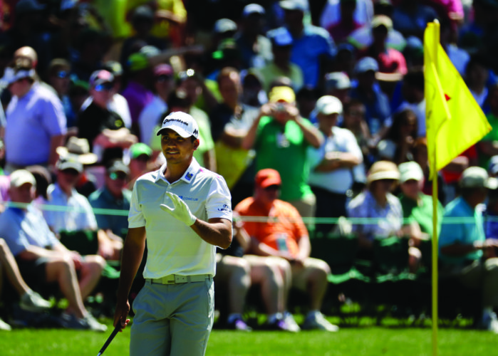 FILE - In this April 4, 2016, file photo, Jason Day, of Australia, waves to spectators on the 16th green during a practice round for the Masters golf tournament,in Augusta, Ga. PGA Tour star Jason Days says he expects to travel to Augusta, Georgia on Friday to start practicing for the Masters, but could pull still out of the seasonÕs first major, depending on his motherÕs prognosis following surgery for lung cancer last week. (AP Photo/Charlie Riedel, File)