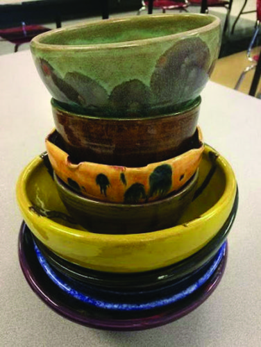 PHOTO PROVIDED Students in the art club have been making ceramic bowls like these for the fundraiser, and have put many hours, days and months into the creation of the bowls.