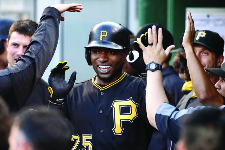 Pittsburgh's Gregory Polanco, center, celebrates in the dugout after hitting a three-run homerun off Arizona pitcher Shelby Miller during the first inning of Tuesday night's game in Pittsburgh. (Associated Press Photo)