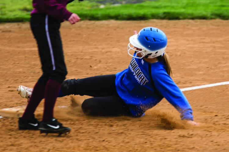 Josie Dersham (right) of Central Mountain High School slides against Altoona High School. The Lady Wildcats defeated Altoona, 9-6. (The Express/Spencer McCoy)