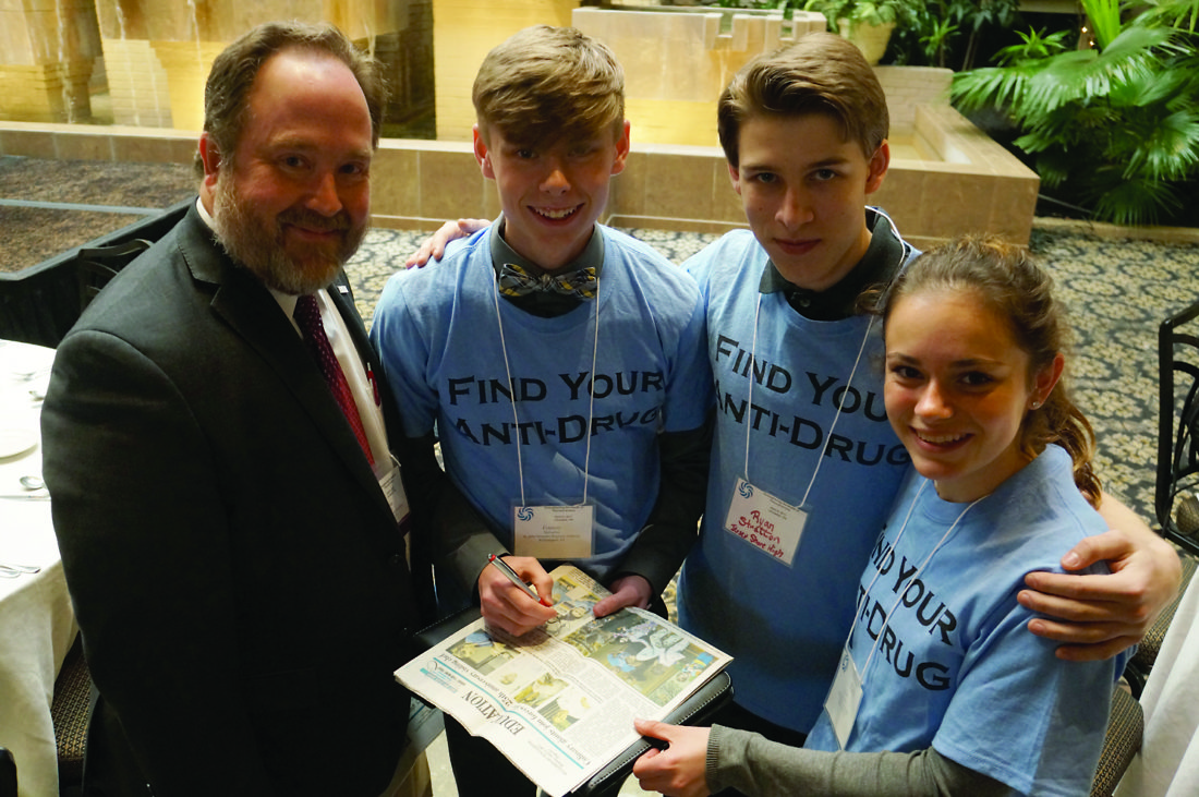 High school students talk with the President of American Public Health Association Tom Quade. They are, from left, Connery McFadden, Ryan Stratton and Mary McMahon.