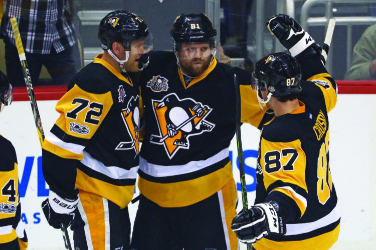 Pittsburgh Penguins' Phil Kessel (81) celebrates his goal with Patric Hornqvist (72) and Sidney Crosby (87) during the first period in Game 5 of an NHL first-round hockey playoff series against the Columbus Blue Jackets in Pittsburgh, Thursday, April 20, 2017. (AP Photo/Gene J. Puskar)