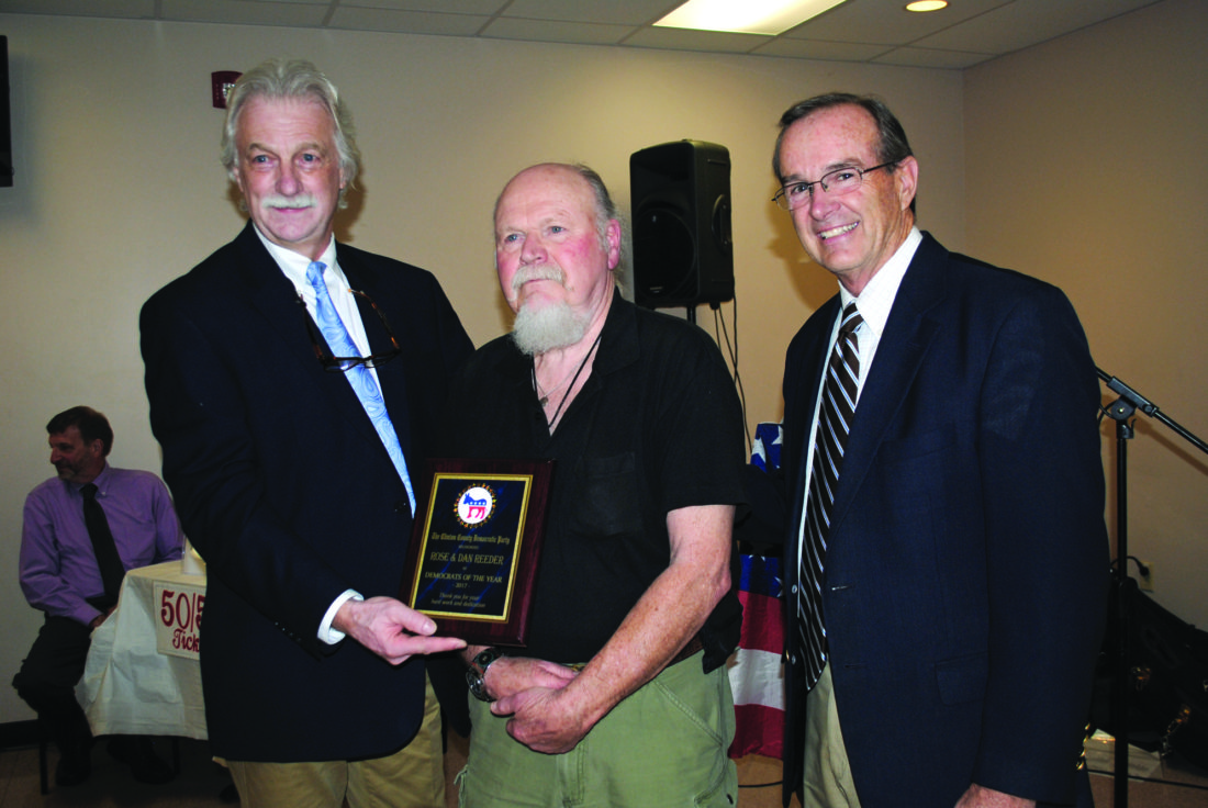 Dan Reeder, center, and his wife Rose(not in attendance) were named Democrats of the Year. At left is Joe Waltz, Clinton County Democratic Party chairman. At right is State Rep. Mike Hanna.