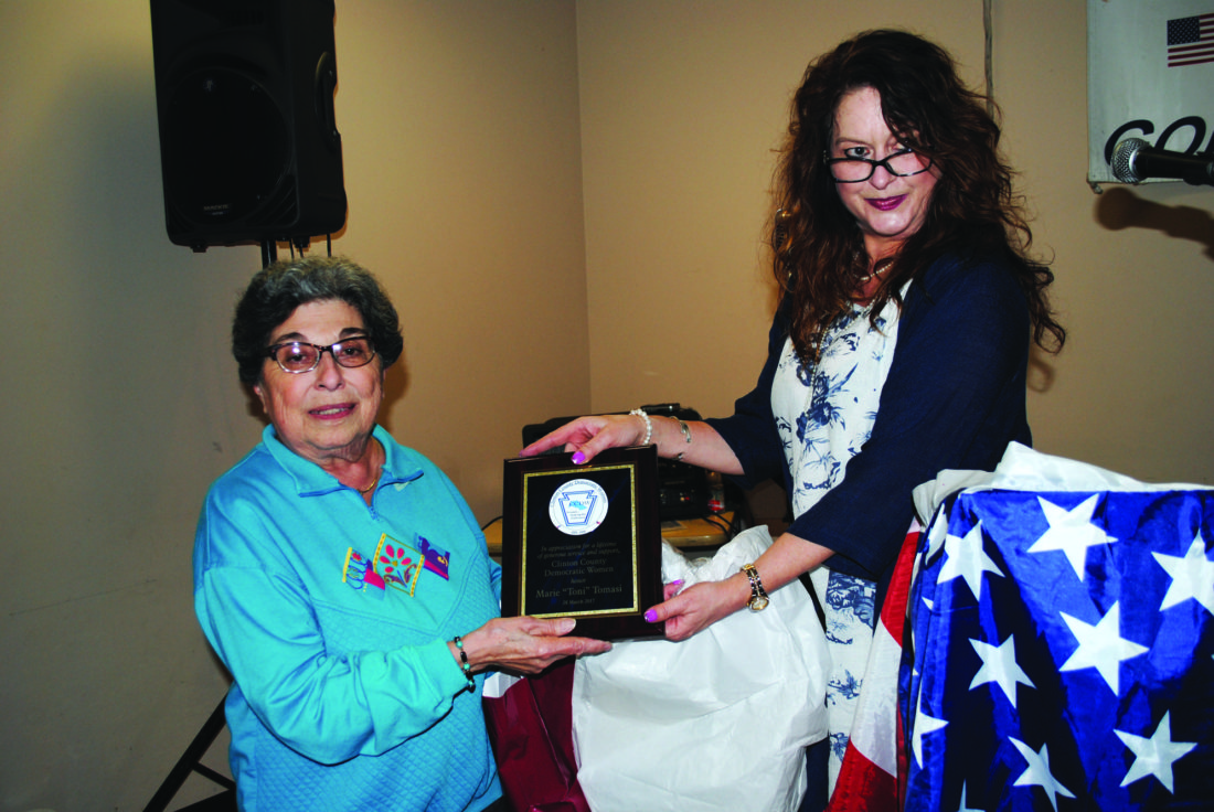 Toni Tomasi, left, receives an award for her years of service with the local Democratic party. Presenting the award is Lianne Russell, president of the Clinton County Democratic Women.
