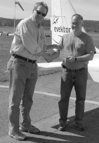 After completing a successful checkride in Selinsgrove, David Mauck, right, receives his coveted Sport Pilot ticket from examiner John Smith.