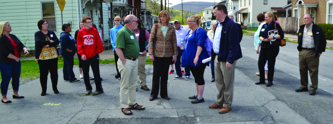 BOB ROLLEY/The Express Renovo and area municipal officials, community volunteers and others stand at Fifth Street and Ontario Avenue at the site of a new boat launch to be built along the West Branch of the Susquehanna River in Renovo.