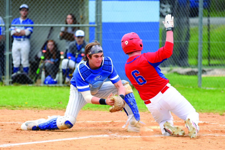 Asher Corl (2) of Central Mountain High School makes an amazing play against Selinsgrove High School tagging out Seals' Morgan Fisher (6). Central Mountain hammered the Selinsgrove Seals, defeating them 12-2. (The Express/Tim Weight)