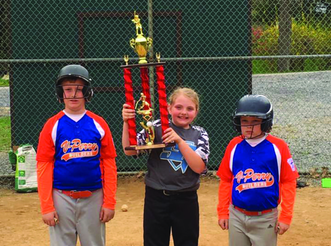 Eva Sockman (middle) recently won the Renovo Little League home run derby held at the fields in East Renovo. Twenty youth sluggers participated in the event with Eva's three home runs - one more than both of her third round challengers,  Connor McClure (left) and Brandon McClure. The player's coaches pitched for their players as they swung for the fences. Eva plays for Renovo's Service Garage team, while both Connor and Brandon play for Port Matilda's V-Perry Construction. (Photo Provided)