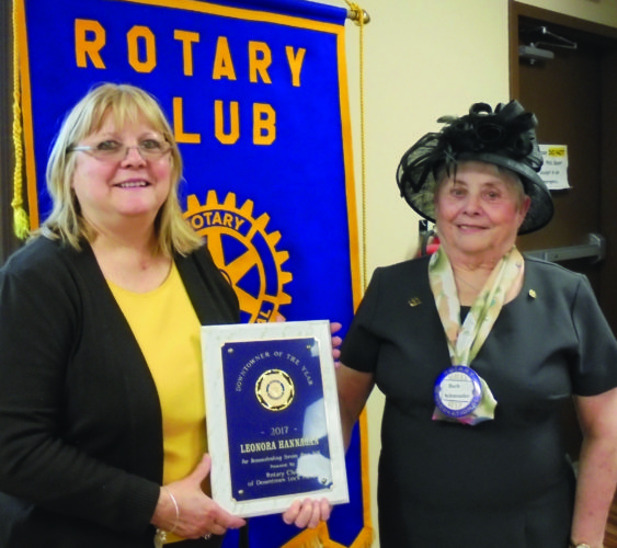 PHOTO PROVIDED City Planner Leonora M. Hannagan, left, is honored as the Downtowner of the Year by the Rotary Club of Downtown Lock Haven. The award is presented by Barb Schmouder, club president.