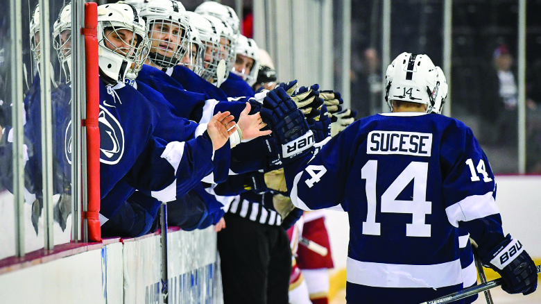 Penn State celebrates a score during their NCAA tournament game with Denver. The No.11 Nittany Lions took on the No.1 Denver Pioneers for a chance of making their first Frozen Four in program history, but were defeated by Denver, 6-3 at U.S. Bank Arena in Cincinnati.  Photo by Mark Selders