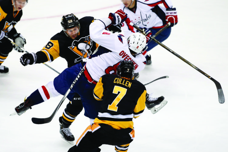 FILE - In this March 20, 2016, file photo, Pittsburgh Penguins' Kris Letang (58) checks Washington Capitals' Alex Ovechkin (8) off the puck during the first period of an NHL hockey game in Pittsburgh. The Capitals and Penguins are almost unchanged from their playoff meeting a year ago, but the small differences could make a major impact in their second-round series. Pittsburgh doesnÕt have defenseman Kris Letang, while Washington has added depth in center Lars Eller and defenseman Kevin Shattenkirk that makes it think it can topple the defending Stanley Cup champions. (AP Photo/Gene J. Puskar, File)