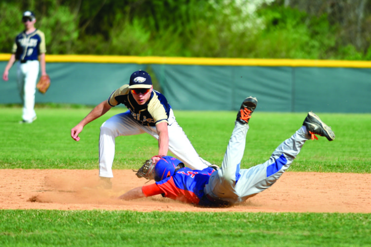 Bald Eagle Area High School's Garret Barnhart (3) tags out a player from St. Joseph's at second base yesterday in Wingate. (The Express/Tim Weight)