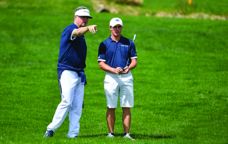 Penn State's Cole Miller with head coach Greg Nye during final round play of the Rutherford Intercollegiate at the Penn State Blue Golf Course on the University Park Campus, April 16, 2016.  Photo by Mark Selders