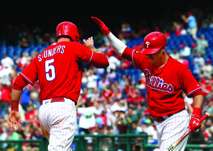 Philadelphia Phillies' Michael Saunders (5)  is congratulated by Andrew Knapp after he scored on an RBI triple by Brock Stassi during the sixth inning of a baseball game against the Miami Marlins, Thursday, April 27, 2017, in Philadelphia. (AP Photo/Tom Mihalek)