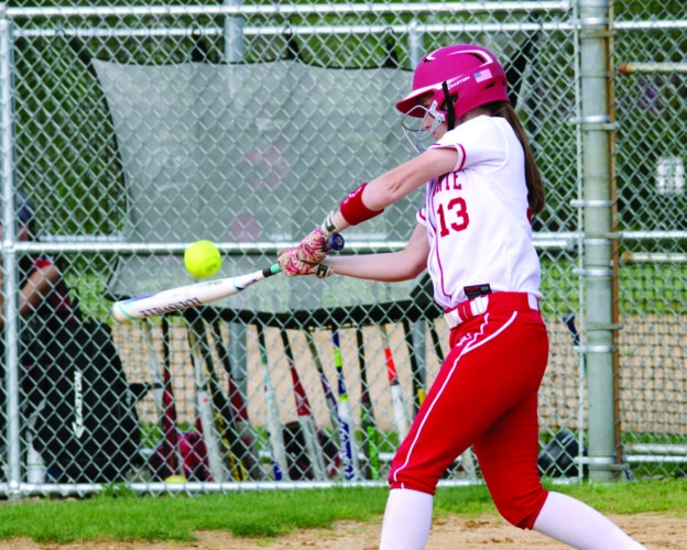 Bellefonte's Emma DeHass swings at a pitch in the Red Raiders' 6-5 victory over Clearfield High School. Bellefonte is now 11-2 on the season. (TIM WEIGHT/FOR THE EXPRESS)