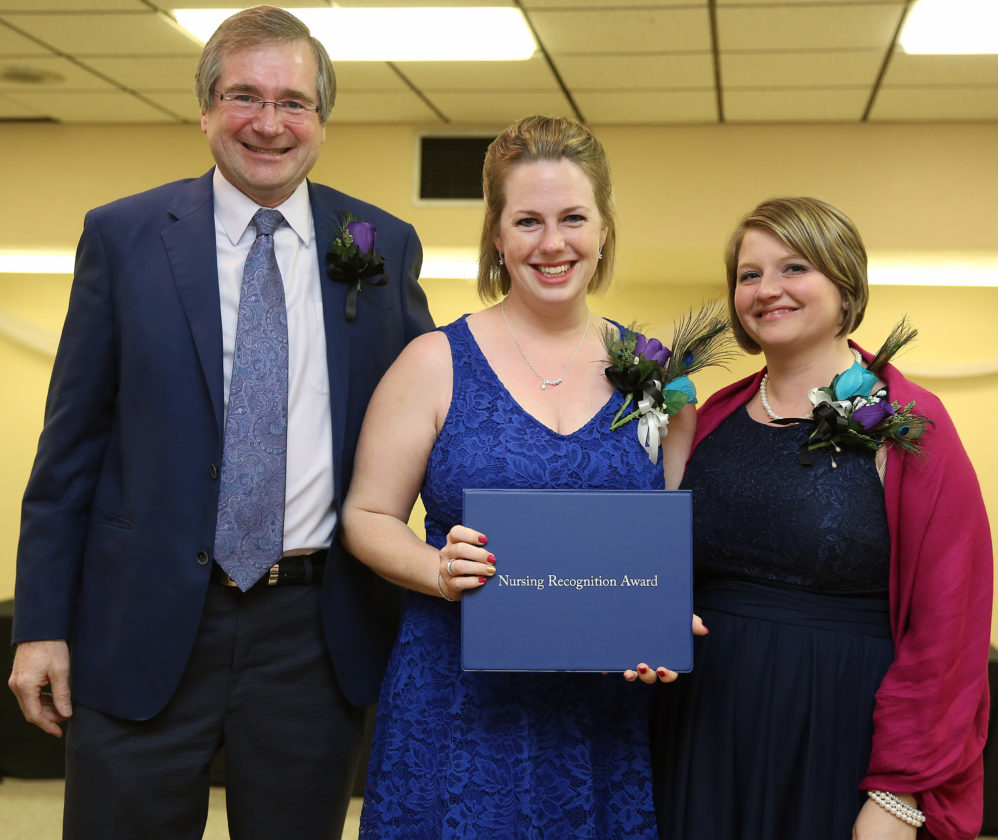 """PHOTO PROVIDED Daniel Glunk, MD, vice president and chief quality officer of UPMC Susquehanna, presents Amanda Raymond, RN, with the """"Above Clinical Excellence (ACE)"""" Educator Award. At right is Raymond's manager, Lesha Trostle, BSN, RN-BC."""