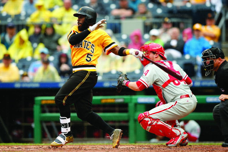Pittsburgh Pirates third baseman Josh Harrison (5) hits a single in the sixth inning against the Philadelphia Phillies during a baseball game in Pittsburgh, Sunday, May 21, 2017. (AP Photo/Jared Wickerham)