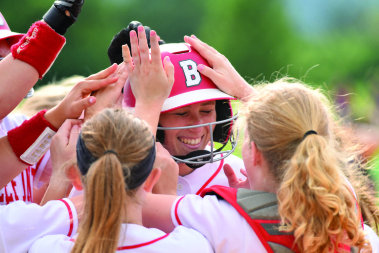 Tara Baney (27) of Bellefonte High School is met at home plate after a solo homerun. She led the way for the Red Raiders with 10 strikeouts and only allowing four hits. Bellefonte heads to the district championship game on Wednesday. (For The Express/Tim Weight)