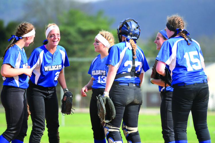 Central Mountain High School's Caitlyn Brush (13), Bailee Renninger (37), Jennifer Skow (15) and other Lady Wildcats gather together after a win against Jersey Shore High School. Central Mountain kicks off the playoffs today. (The Express/Tim Weight)