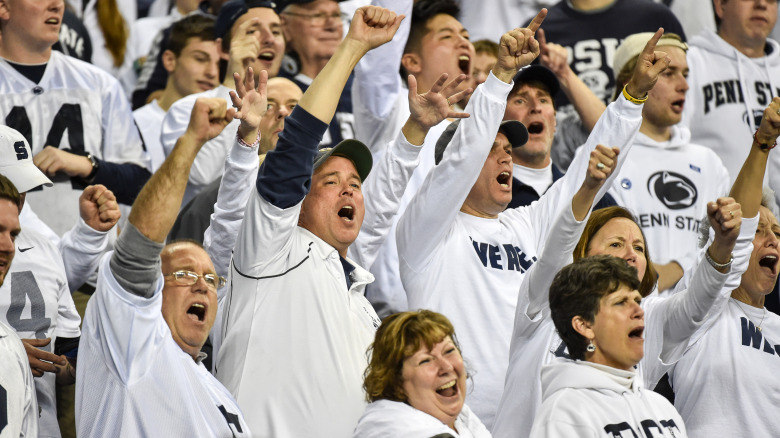 Penn State fans celebrate after the Nittany Lions defeated the Badgers, 38-31 to claim the 2016 Big Ten Football Conference Championship.  Photo by Mark Selders