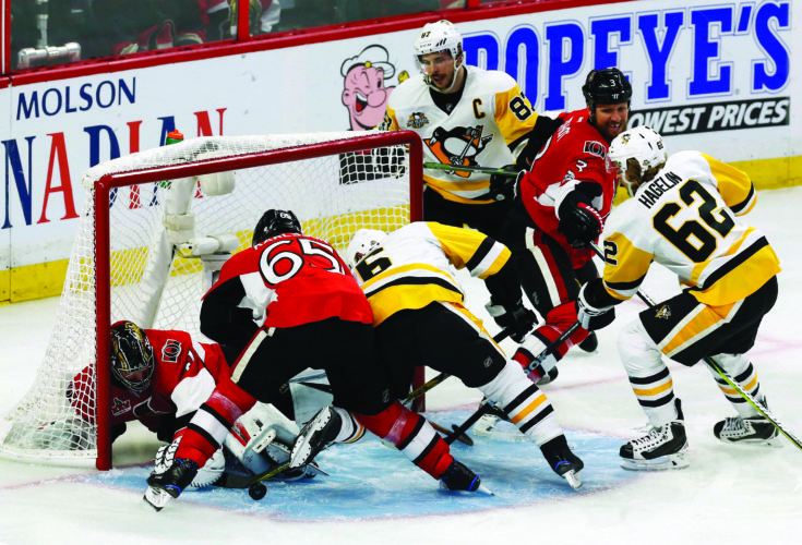 Pittsburgh Penguins defenseman Trevor Daley (6) battles with Ottawa Senators defenseman Erik Karlsson (65) in front of Senators goalie Craig Anderson (41) during the second period of game six of the Eastern Conference final in the NHL Stanley Cup hockey playoffs in Ottawa on Tuesday, May 23, 2017. (Fred Chartrand/The Canadian Press via AP)