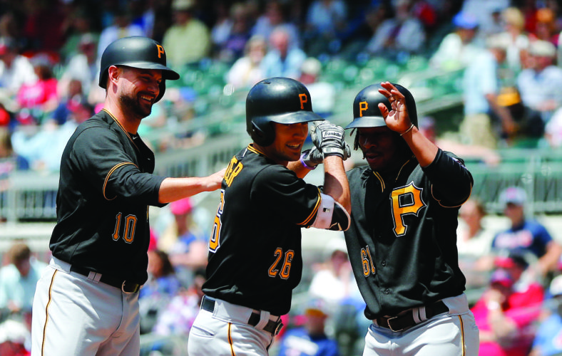 Pittsburgh Pirates' Adam Frazier (26) celebrates with Jordy Mercer (10) and Gift Ngoepe (61) after hitting a three-run home run in the second inning of a baseball game against the Atlanta Braves Thursday, May 25, 2017, in Atlanta. Pittsburgh won 9-4. (AP Photo/John Bazemore)