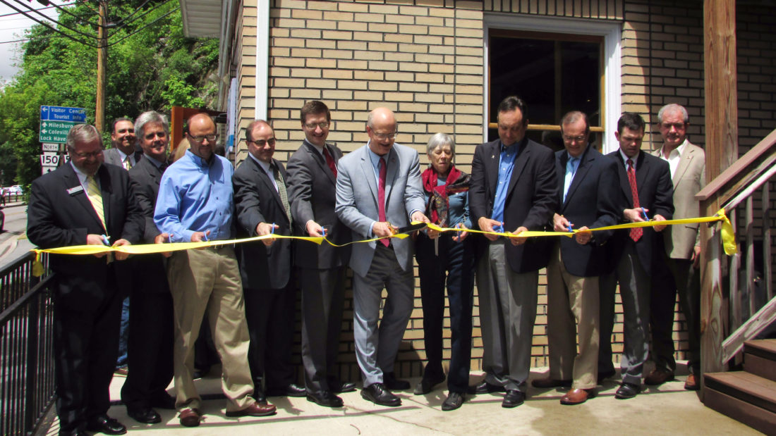 EMMA GOSALVEZ/THE EXPRESS Community and business leaders cut the ribbon for the opening of SpringBoard, Bellefonte's first and only business incubator, yesterday on Water Street.