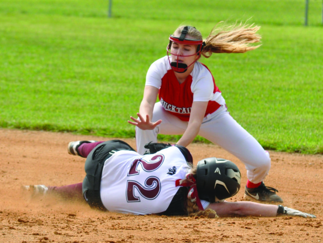 North East Bradford's Katie Boardman slides safely onto second as Bucktail's Kayli Casper puts on the late tag in the Lady Bucks 14-0 loss against the Lady Panthers.