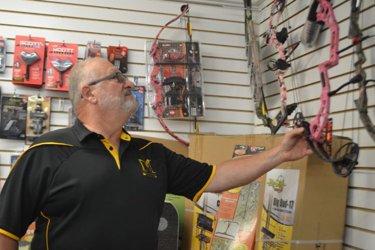 BRECKIN WELLS   The Marietta Times On Thursday, Steve Pettebone, 67, of Marietta checks out the archery gear at Magnum Get Your Shot On located at 1259 Hartline Road in Whipple.