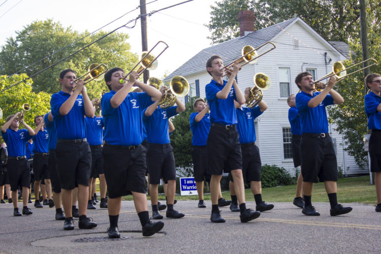 JANELLE PATTERSON   The Marietta Times Warren High School's marching band performs as part of the Barlow Fair Parade Friday.