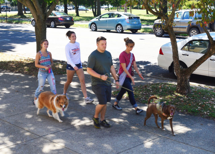 DOUG LOYER  Special to the Times Many dogs and people got their exercise during the Wags N Whiskers Paws Walk Sunday in Muskingum Park.