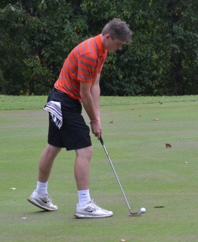 RON JOHNSTON The Marietta Times Marietta golfer Heath Hill competes in a high school match against Warren earlier this season at Marietta Country Club.