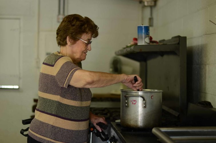 On Wednesday, Octoberfest Food Chairwoman Mildred Schwendeman makes vegetable soup for the workers setting up for Octoberfest on Friday.  HANNAH  KITTLE    The Marietta Times