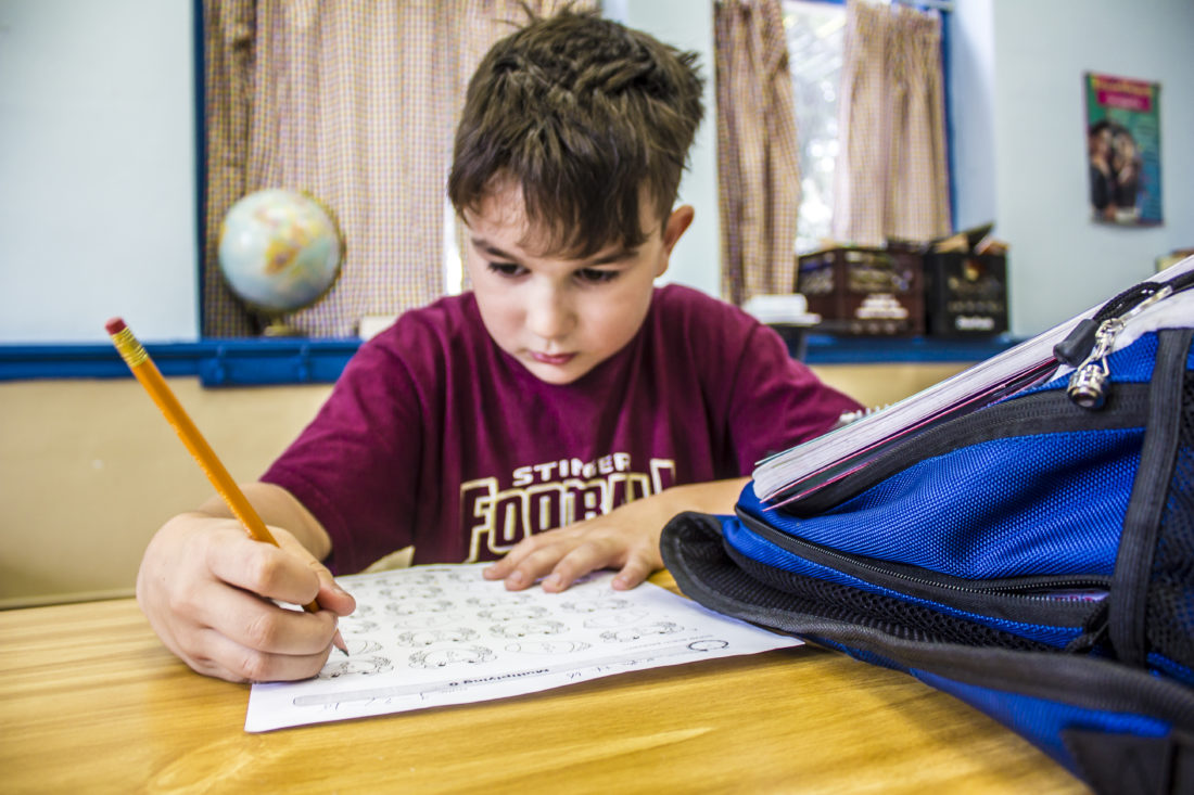 JANELLE PATTERSON   The Marietta Times Dylan Pucella, 8, of Williamstown, completes his math homework Thursday at the Ely Chapman Education Foundation's after-school program.