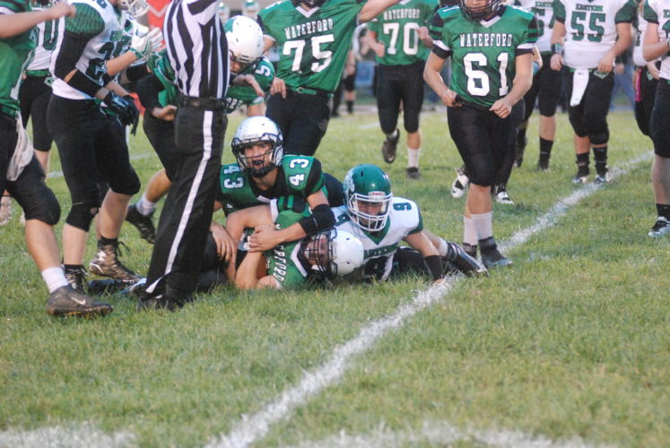MIKE MORRISON The Marietta Times Waterford's Braden Bellville, center, recovers a fumble during a high school football game against Eastern Friday. Waterford's Ty McGraw (43) and Eastern's Josh Brewers (9) also try to recover.