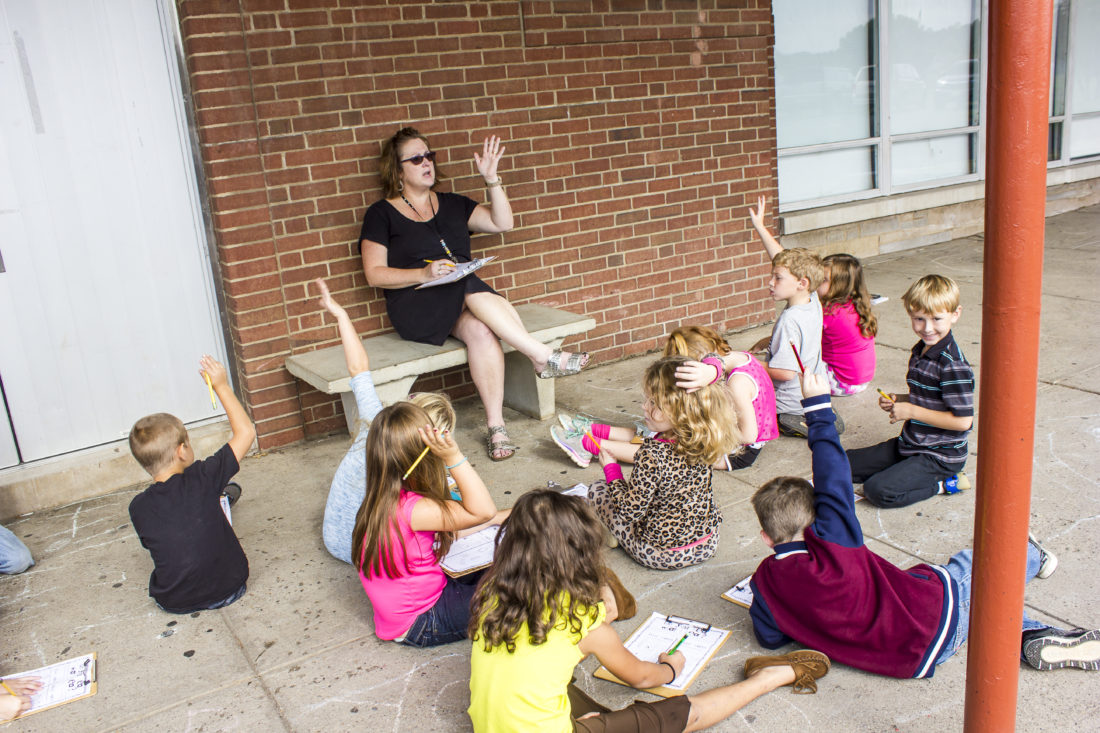 JANELLE PATTERSON   The Marietta Times Beth Maidens teaches listening skills while sitting in the breeze outside Warren Elementary Wednesday with her kindergarten class.