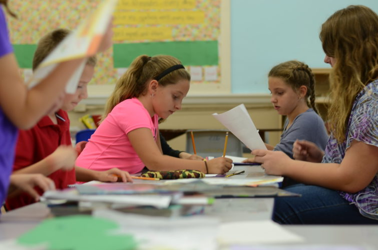 HANNAH KITTLE   The Marietta Times Maevry McCombs, 7, of Marietta, and her twin sister Adele McCombs, 7, of Marietta, work on their homework at the Ely Chapman Education Foundation afterschool program on Thursday.