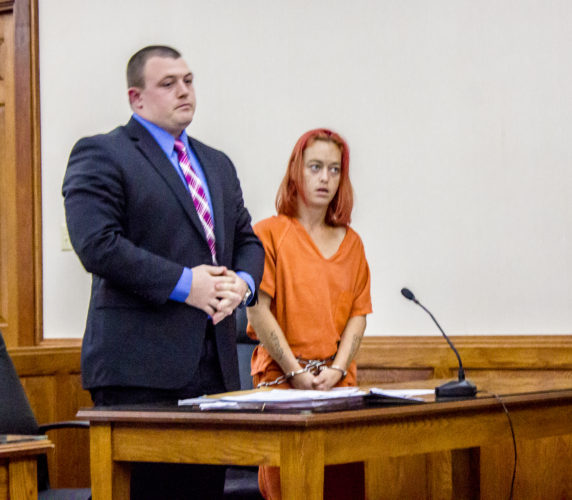 Beau Cross, left, represents Amy Books, 30, of 736 Greene St., Marietta, at her bond and arraignment hearing in Judge Ed Lane's court Friday.   JANELLE PATTERSON   The Marietta Times