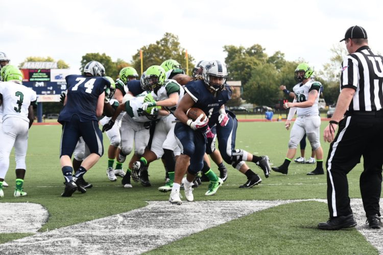 Photo by Nate Knobel Marietta College's Roger Walker (1) runs into the end zone during a college football game against Wilmington last week at Don Drumm Stadium.
