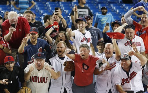 Cleveland Indians fans cheer after the Indians defeated the Toronto Blue Jays 3-0 in Game 5 of the baseball American League Championship Series in Toronto on Wednesday, Oct. 19, 2016. (Mark Blinch/The Canadian Press via AP)