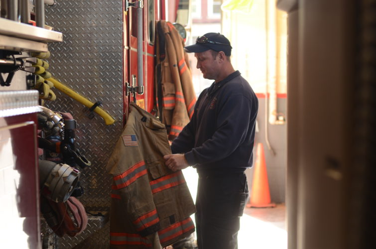 HANNAH KITTLE   The Marietta Times Kyle Talbott, firefighter at the Marietta Fire Department, picks up his turn-out gear at work on Tuesday.