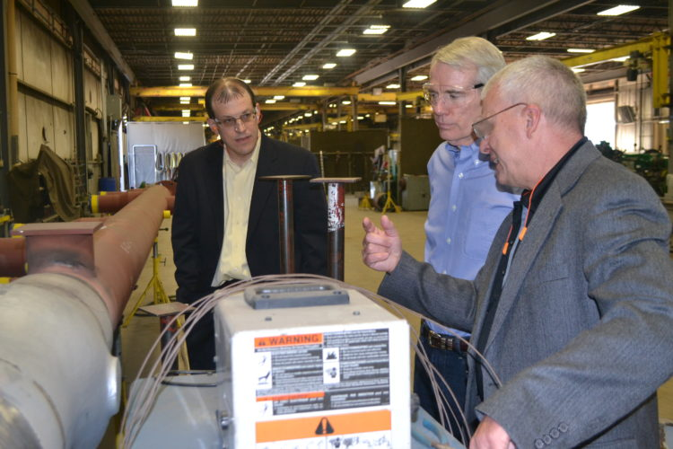 PEYTON NEELY   The Marietta Times U.S. Senator Rob Portman, center, learns first-hand about the equipment used at Pioneer Pipe on Tuesday with a tour given by CEO and President Mike Archer, left, and Chief Operating Officer Matthew Hilverding.