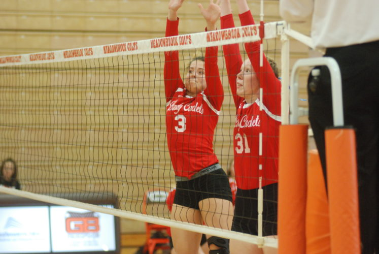 MIKE MORRISON The Marietta Times Fort Frye's Kelsey Sampson, left, and Kasey Buchanan go up for a block during a high school tournament volleyball match against Hiland Wednesday at Meadowbrook High School in Byesville.