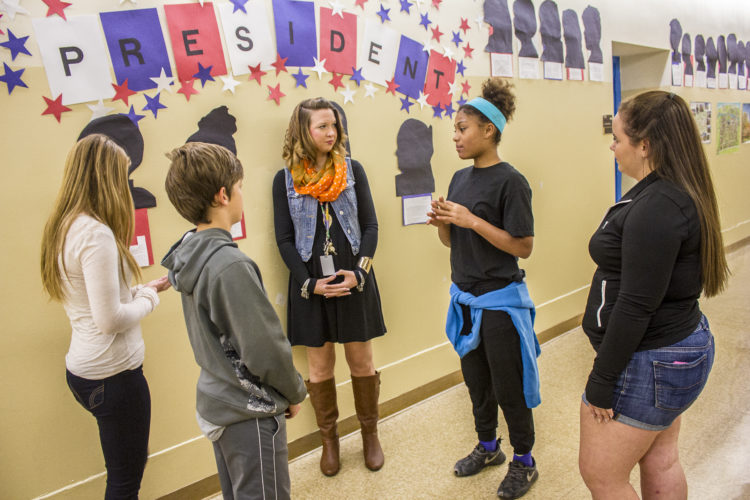 JANELLE PATTERSON   The Marietta Times Students Kimberly Tatro, far left, 14, of Lower Salem, Tyson Shaffer, 13, of Marietta, Jessica Smith, 13, of Marietta and Kaitlynn Williams, 14, of Marietta, far right, explain to Principal Brittany Schob, center, what they have learned about the election process and current issues facing the nation.