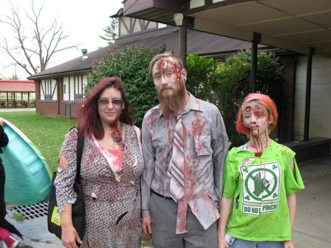 Photo submitted by Jeremy Miller  Marietta resident Megan Miller, 36, with husband Jeremy Miller, 36, and daughter Rylee Miller, 11, dressed at zombies for the Zombie Walk in Parkersburg on Oct. 15 and plan to attend the Zombie Fest in Marietta today.
