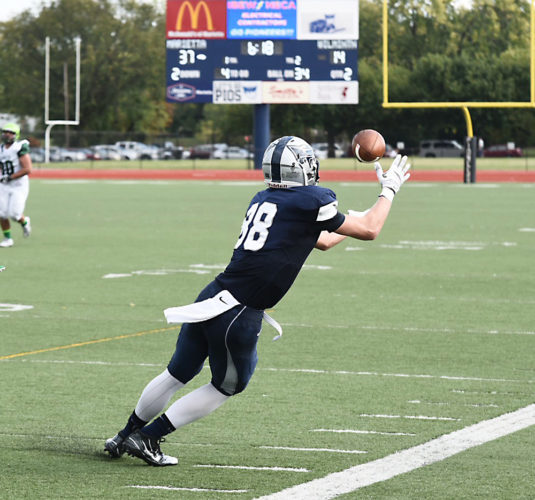 Photo by Nate Knobel Marietta College's Andrew Barker, right, catches a pass against Wilmington during a college football game earlier this season at Don Drumm Stadium.