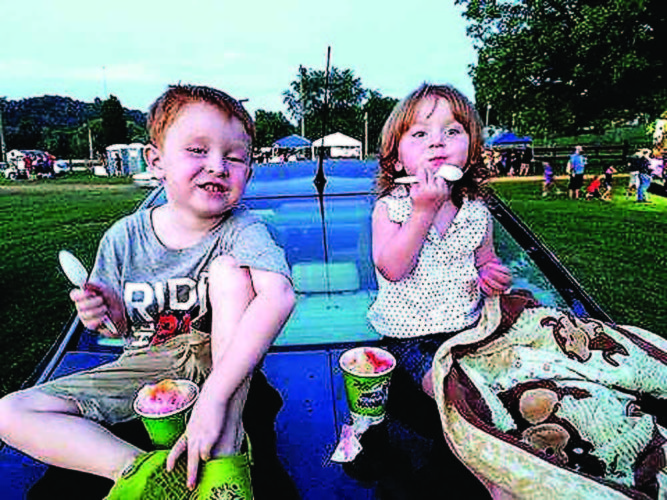 Photo submitted by J.D. Nicolais Two children enjoy their sno-cones at the M.A.I.N Movies Drive-In Theater in Mineral Wells.