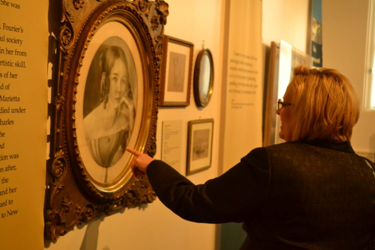 PEYTON NEELY   The Marietta Times Jeri Knowlton, secretary of the Friends of the Museums board, looks at artwork in one of the new exhibits at the Campus Martius Museum on Wednesday that will be showcased during An Evening at the Museum on Friday.