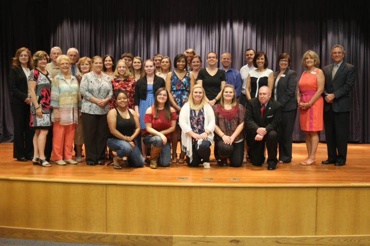 Scholarship recipients along with donors and presenters, front row, from left, Leslie Croston; Nicole Robertson; Brittany Tipton, Haleigh Black, Brad Merritt. Row two: Louise Homes; Suzanne Paugh: Megan Warner; Kristen Hanes; Shanell Evans; Rebecca Mullans; Kim Blackburn; Anna Rittenhouse; Gayle Ebersole; Dr. Bradley Ebersole. Row three: Dr. Carol Wylie-Hancock; Joanne Ingram; Janette Hale; Lexie Gutberlet; Courtney McIntosh; Rachel Howard; Jason Williams; Ray Blackburn. Row four: Tracy Jensen, Ron Homes; Henry Goehring; Jared Rackowitz; Ian Harris; Cody Lee.