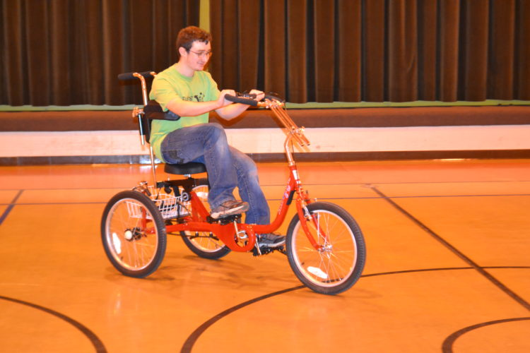 PEYTON NEELY   The Marietta Times Daniel Jenks, 15, of Lower Salem, rides around on the new AmTryke adaptive tricycle at Ewing School on Friday morning.